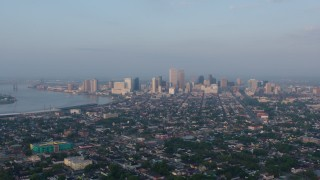 PVED01_004 - 4K stock footage aerial video approach the French Quarter and Downtown New Orleans, Louisiana sunrise