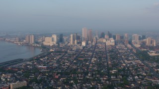 PVED01_005 - 4K stock footage aerial video of fly over French Quarter to approach Downtown at sunrise, New Orleans, Louisiana