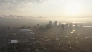 PVED01_008 - 4K stock footage aerial video of Downtown New Orleans and Superdome with view of rising sun, Louisiana