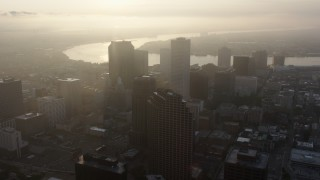 PVED01_010 - 4K stock footage aerial video fly over Downtown New Orleans toward the Mississippi River at sunrise, Louisiana