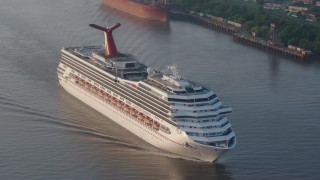 PVED01_012 - 4K stock footage aerial video of Carnival Cruise ship sailing the Mississippi River at sunrise, New Orleans, Louisiana