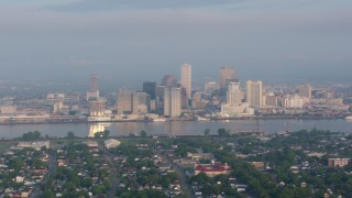 PVED01_015 - 4K stock footage aerial video of Downtown New Orleans skyline seen from across the Mississippi River at sunset, Louisiana