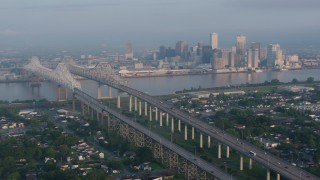 PVED01_016 - 4K stock footage aerial video orbit Crescent City Connection Bridge and Downtown New Orleans at sunrise, Louisiana