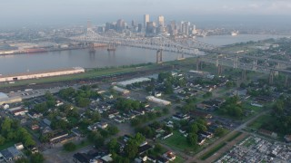 PVED01_017 - 4K stock footage aerial video tilt from cemetery to reveal Crescent City Connection and Downtown at sunrise, Louisiana