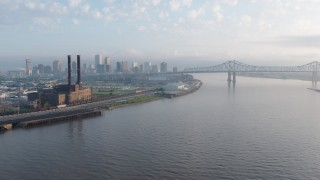 PVED01_019 - 4K stock footage aerial video of Downtown New Orleans and Crescent City Connection seen from the river at sunrise, Louisiana