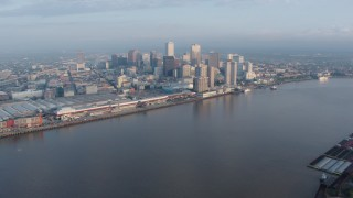 PVED01_022 - 4K stock footage aerial video of wide orbit of Downtown New Orleans at sunrise, Louisiana