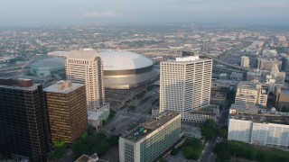PVED01_025 - 4K stock footage aerial video of Downtown New Orleans and City Hall, approach the Superdome at sunrise, Louisiana