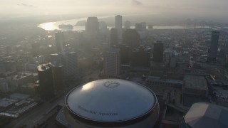 PVED01_027 - 4K stock footage aerial video tilt to reveal and the Superdome in Downtown New Orleans at sunrise, Louisiana