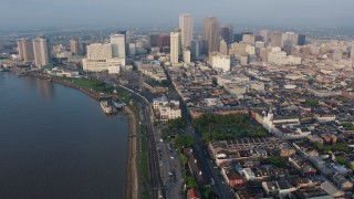 PVED01_034 - 4K stock footage aerial video of St. Louis Cathedral and Downtown New Orleans at sunrise, Louisiana