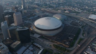 PVED01_042 - 4K stock footage aerial video orbit of the Superdome and the New Orleans Arena in Downtown New Orleans at sunrise, Louisiana
