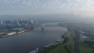 PVED01_044 - 4K stock footage aerial video of Crescent City Connection Bridge at sunrise spanning the Mississippi River, New Orleans, Louisiana