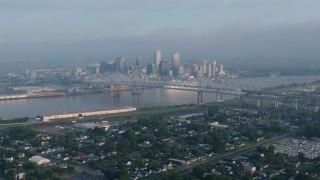 PVED01_045 - 4K stock footage aerial video wide orbit of Crescent City Connection and Downtown New Orleans at sunrise seen from Gretna, Louisiana