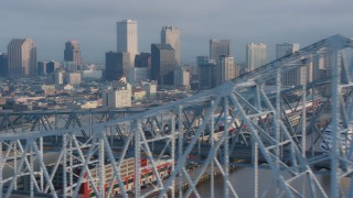 PVED01_047 - 4K stock footage aerial video flyby the Crescent City Connection Bridge, reveal Downtown New Orleans skyline at sunrise, Louisiana