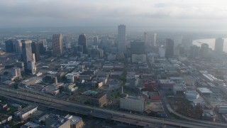 PVED01_048 - 4K stock footage aerial video approach Downtown New Orleans Skyscrapers at sunrise, Louisiana