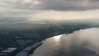 PVED01_050 - 4K stock footage aerial video of Bywater and the Mississippi River in New Orleans at sunrise, Louisiana