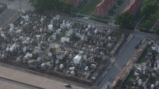 PVED01_054 - 4K stock footage aerial video of two cemeteries in the French Quarter of New Orleans at sunrise, Louisiana