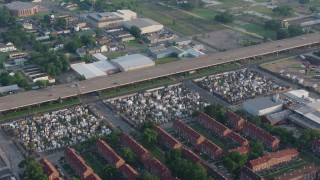 PVED01_056 - 4K stock footage aerial video of orbiting three French Quarter cemeteries in New Orleans, Louisiana at sunrise