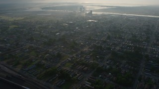 PVED01_058 - 4K stock footage aerial video of flying over urban neighborhoods in the Upper Ninth Ward at sunrise, New Orleans, Louisiana