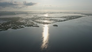 PVED01_064 - 4K stock footage aerial video approach marshland in St. Bernard Parish at sunrise in Louisiana