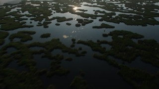 PVED01_065 - 4K stock footage aerial video flying by marshland in St. Bernard Parish at sunrise, Louisiana