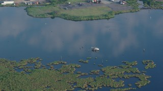 PVED01_066 - 4K stock footage aerial video orbit a capsized boat in the water at sunrise in St. Bernard Parish, Louisiana