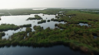 PVED01_069 - 4K stock footage aerial video fly over marshland and bayou at sunrise in St. Bernard Parish, Louisiana