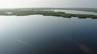 PVED01_070 - 4K stock footage aerial video tilt to reveal marshland and bayou at sunrise in St. Bernard Parish, Louisiana