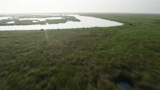 PVED01_071 - 4K stock footage aerial video tilt and fly low over marshland and bayou in St. Bernard Parish, Louisiana at sunrise