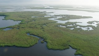 PVED01_074 - 4K stock footage aerial video approach and fly over Marshland in a St. Bernard Parish bayou at sunrise, Louisiana