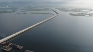 PVED01_077 - 4K stock footage aerial video orbit a surge barrier in the bayou marshland of St. Bernard Parish at sunrise, Louisiana
