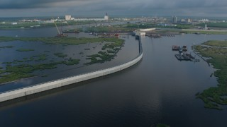 PVED01_079 - 4K stock footage aerial video surge barrier and gate in a St. Bernard Parish Bayou at sunrise, Louisiana