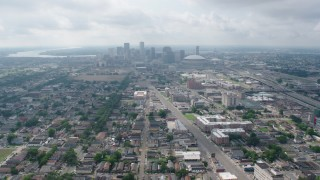 PVED01_109 - 4K stock footage aerial video wide orbit of Mid-City streets to the Downtown skyline of New Orleans, Louisiana