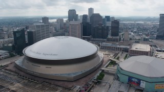 PVED01_111 - 4K stock footage aerial video tilt from freeway interchange to reveal Superdome and Downtown New Orleans, Louisiana