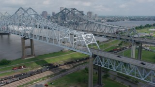 PVED01_113 - 4K stock footage aerial video flyby Crescent City Connection Bridge and reveal Downtown New Orleans skyline, Louisiana