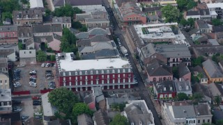 PVED01_118 - 4K stock footage aerial video fly over French Quarter apartment building and street in New Orleans, Louisiana