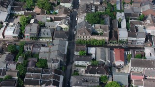 PVED01_119 - 4K stock footage aerial video bird's eye of French Quarter street, tilt to reveal Downtown New Orleans skyscrapers, Louisiana