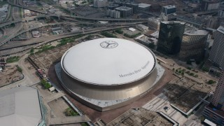 PVED01_121 - 4K stock footage aerial video orbit of the Superdome in Downtown New Orleans, Louisiana