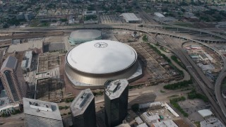 PVED01_122 - 4K stock footage aerial video orbiting the Louisiana Superdome in Downtown New Orleans, Louisiana