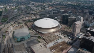 PVED01_124 - 4K stock footage aerial video slow orbit of the Superdome and New Orleans Arena in Downtown New Orleans, Louisiana