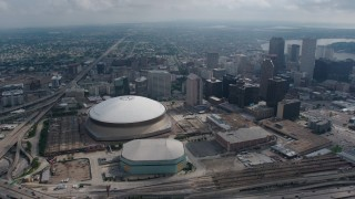 PVED01_125 - 4K stock footage aerial video wide orbit of the Superdome, New Orleans Arena and Downtown New Orleans skyscrapers, Louisiana