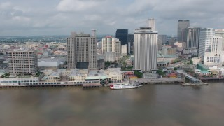 PVED01_131 - 4K stock footage aerial video flyby Downtown New Orleans to reveal Cruise Ship at port and the Crescent City Connection, Louisiana