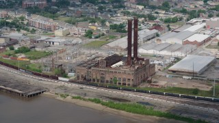 PVED01_132 - 4K stock footage aerial video approach riverfront power plant in the Garden District of New Orleans, Louisiana
