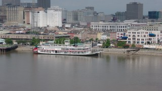 PVED01_135 - 4K stock footage aerial video of Steamboat Natchez on the French Quarter riverfront in New Orleans, Louisiana