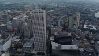 PVED01_140 - 4K stock footage aerial video tilt to reveal and fly over Downtown New Orleans skyscrapers toward French Quarter, Louisiana
