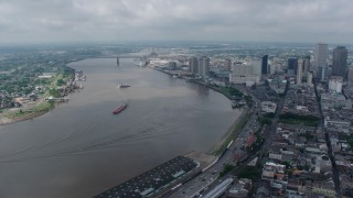 PVED01_142 - 4K stock footage aerial video orbit the Mississippi River and Downtown New Orleans, seen from the French Quarter, Louisiana