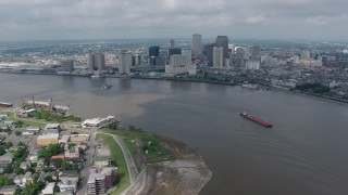 PVED01_143 - 4K stock footage aerial video fly over Mississippi River to approach Downtown New Orleans, Louisiana