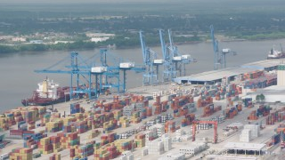 PVED01_147 - 4K stock footage aerial video orbit cranes and rows of containers at the Port of New Orleans, Louisiana