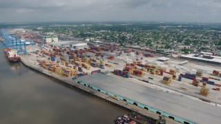PVED01_148 - 4K stock footage aerial video orbit of a cargo ship, cranes and containers at the Port of New Orleans, Louisiana