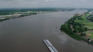 PVED01_150 - 4K stock footage aerial video fly over a barge on the Mississippi River near New Orleans, Louisiana
