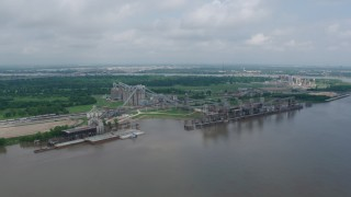 PVED01_152 - 4K stock footage aerial video orbit a riverfront factory in New Orleans, Louisiana
